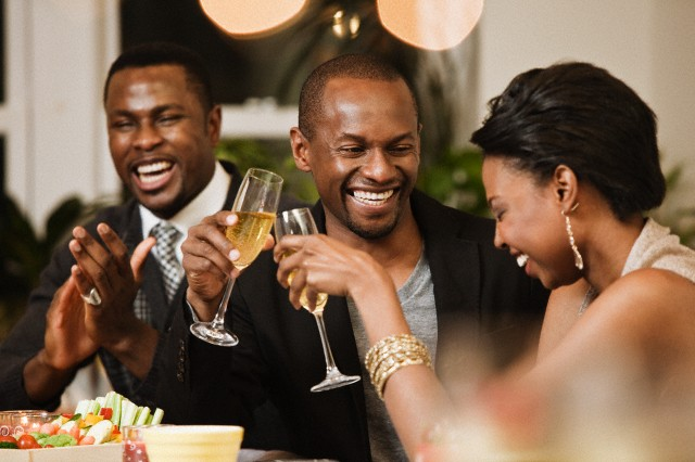Group of friends having fun at party --- Image by © Michael Patrick O'Leary/Corbis